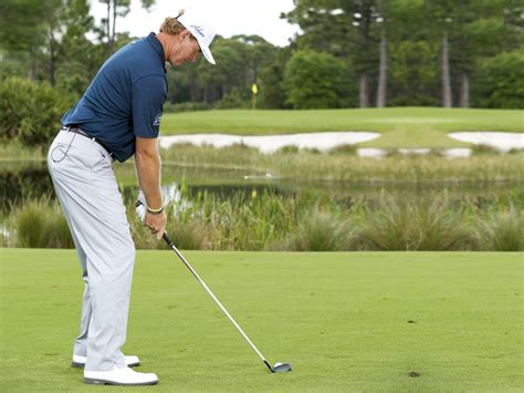ernie els iron swing ernie els how to hit hybrids from bad lies golf monthly
