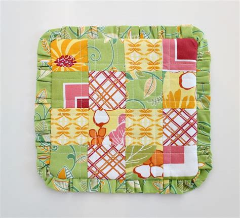 Fast Quilting Projects Pot Holders Mug Rugs Pincushions - patchwork and a ruffle make a pretty mug rug quilting digest