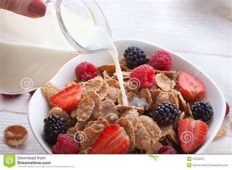 Ejuice Matjan Breakfast Berry Cereal Milk milk pouring into bowl of cereals with fresh berries stock photo image of food appetizer