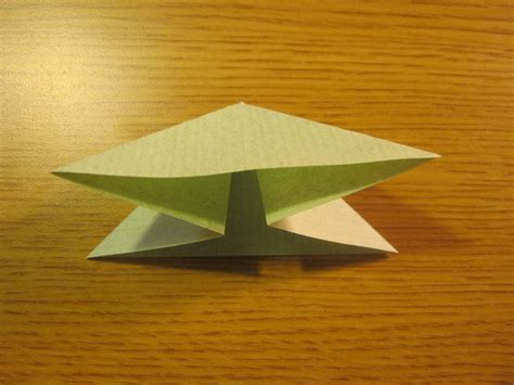 Fold Paper Into Triangle - how to make an origami triangle base 8 steps with pictures