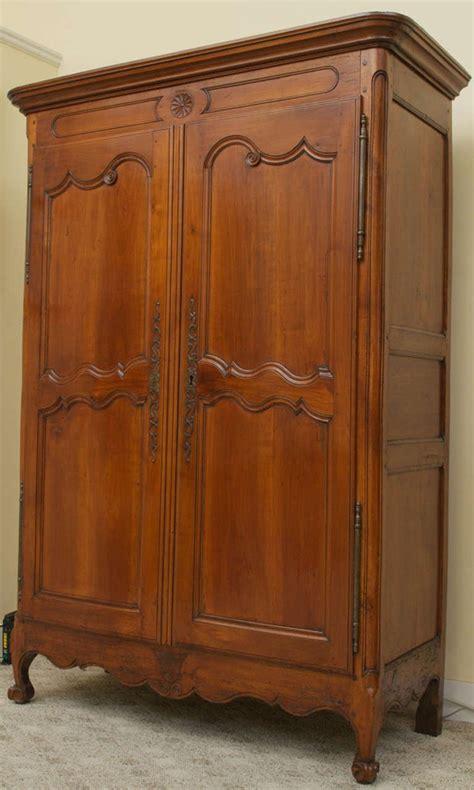 cherry wood armoire wardrobe 18th century cherry wood louis xv armoire at 1stdibs