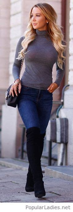 high boots blue jeans  grey blouse