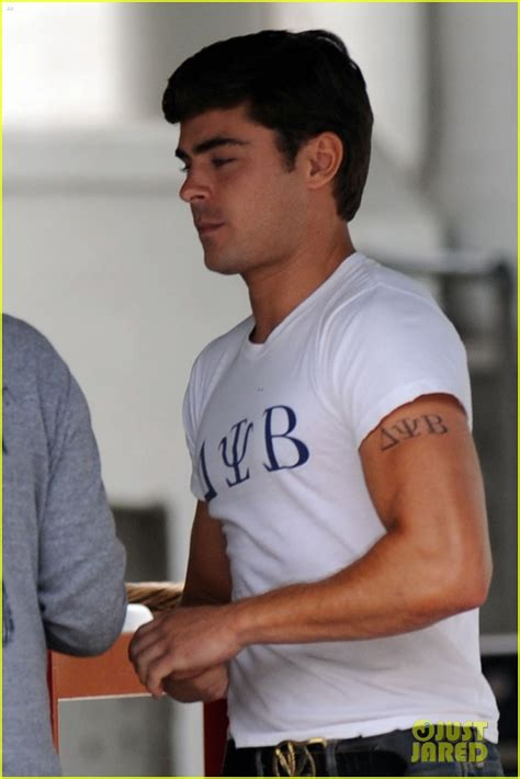 seth rogen tattoos zac efron frat on bulging bicep for townies