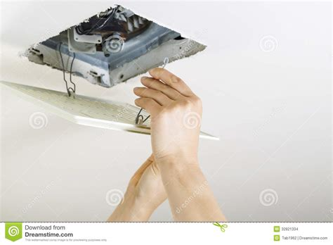 Bathroom Fan On All The Time Installing Clean Bathroom Fan Vent Cover Stock Images