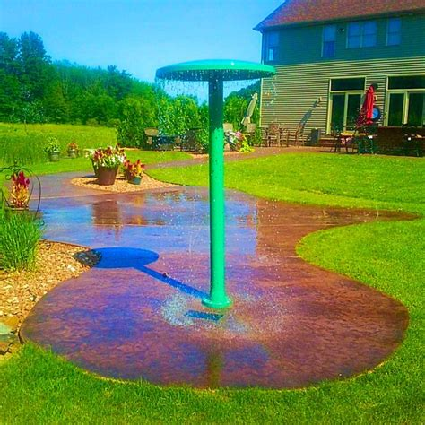 backyard splash park fun little backyard freeform concrete splash pad with 12