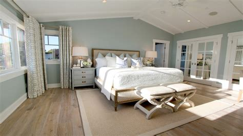 ceiling to floor drapes light blue walls master bedroom