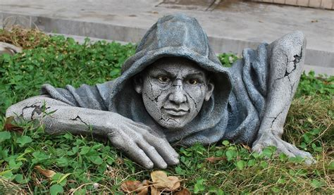 hooded zombie sculpture