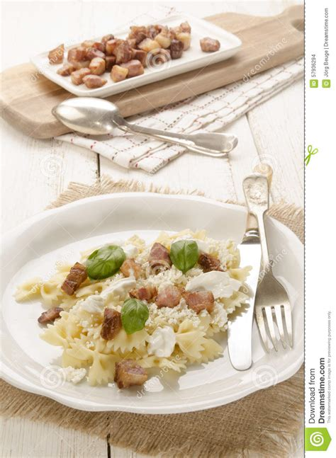 Pasta Cottage by Farfalle Pasta With Cottage Cheese And Sour Stock