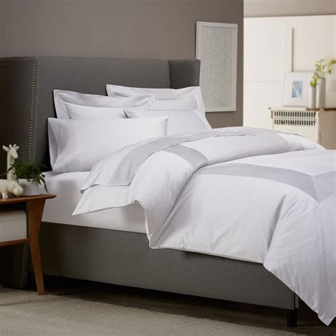 manly bedding get alluring visage by displaying a white comforter sets