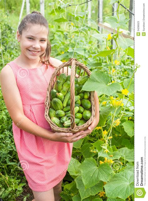 girl with cucumber lovely girl with cucumbers stock photos image 34296023