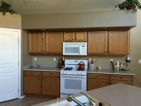 how can i refinish my kitchen cabinets can i refinish my kitchen cabinets diy q a home