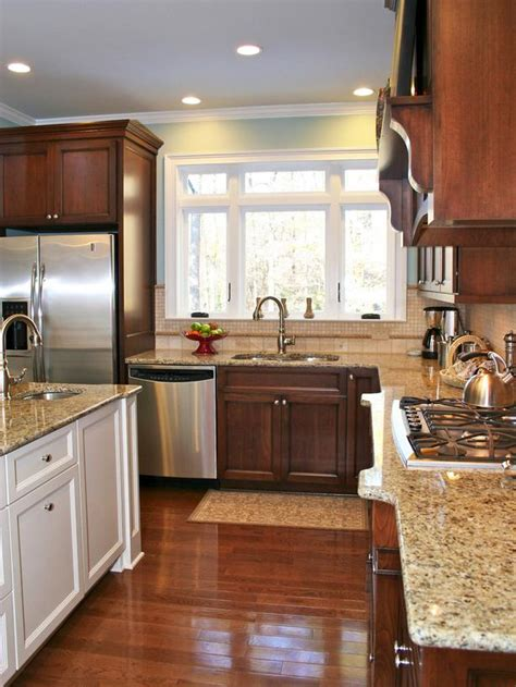 kitchen cabinetry doesn t to match a white island is mixed with warm stained cherry