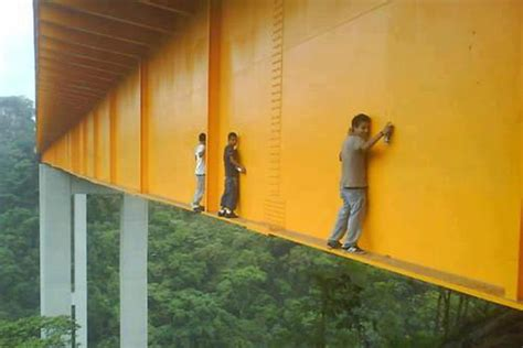 daring graffiti artists tag mexicos  foot high metlac