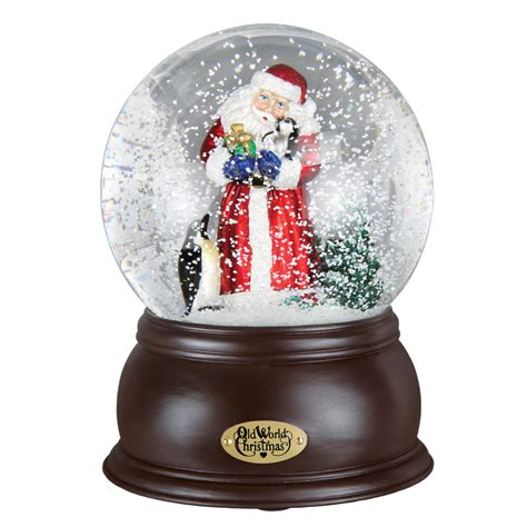 santa with penguin pals old world christmas snow globe 54004