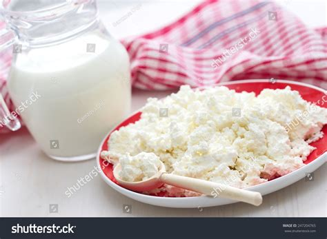 Cottage Cheese From Milk by Fresh Cottage Cheese And Milk Stock Photo 247204765