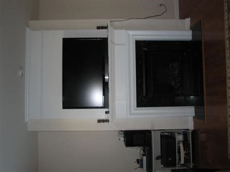 fireplace chimney as av cabinet and tv mount above