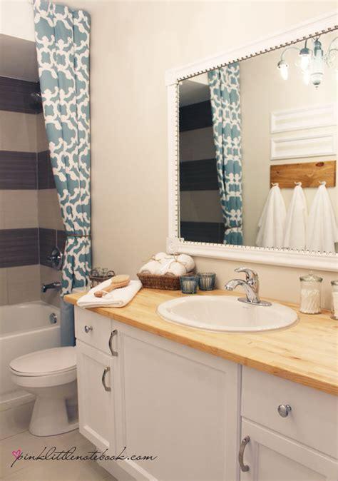 framing a builder grade bathroom mirror diy builder grade upgrades easy home decor projects