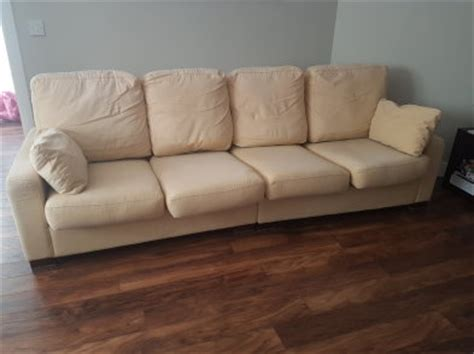 large and comfortable 4 seater creamgold sofa for