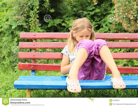 girl sitting on bench girl sitting on bench stock photo image of little star