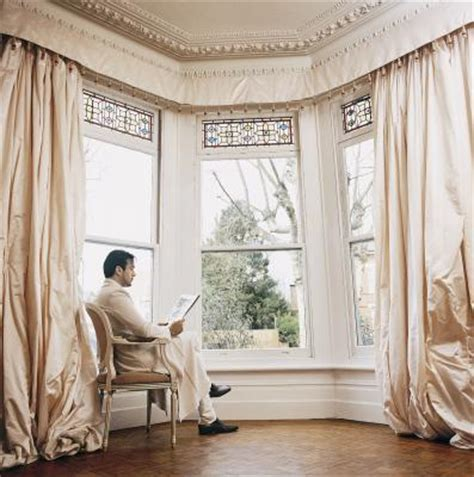 swag curtains for large windows how to hang a curtain swag a large window home