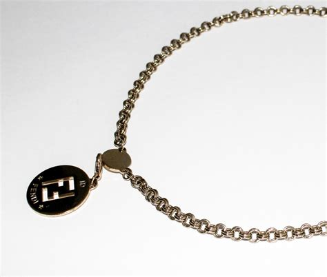fendi logo identification pendant charm and goldtone