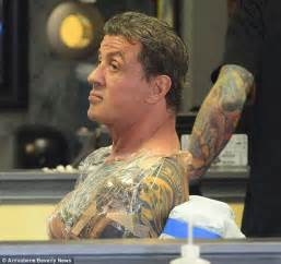 sly stallone 66 adds to his body art collection at