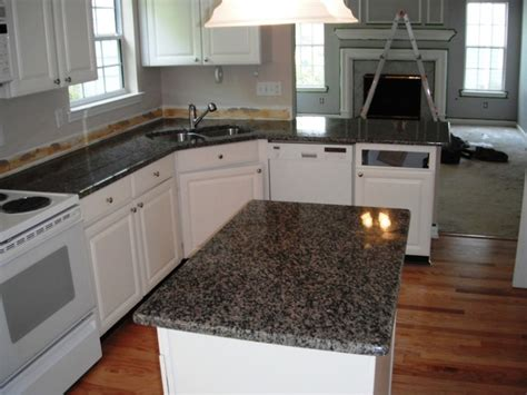 New Caledonia Countertop by Caledonia Granite For White Cabinets Traditional