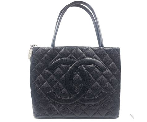 Conrad Sports A New Do A Chanel Caviar Bag by Authentic Vintage Chanel Cc Stitching Black Caviar