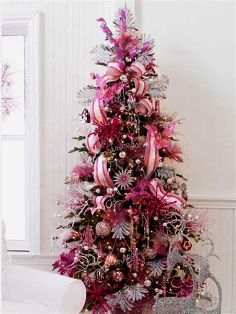 beautiful ligh chritmas tree with pink decorations