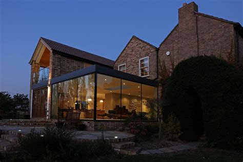 modern traditional house modern glass addition to otherwise traditional home