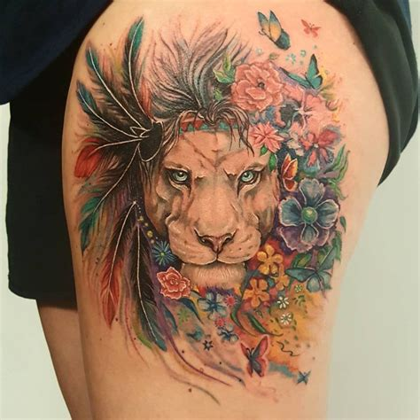 colorful lion tattoo feminine with feathers colorful on thigh