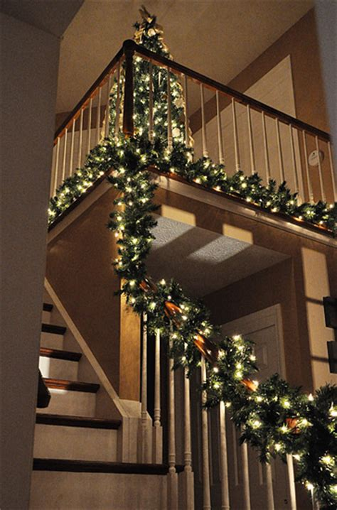 christmas lights for stair banisters my banister is lit i m thinking of calling it lindsay
