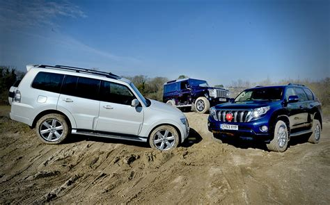 land rover mitsubishi test land rover defender vs toyota land cruiser and