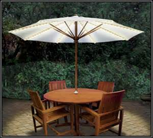 Patio table and chairs with umbrella