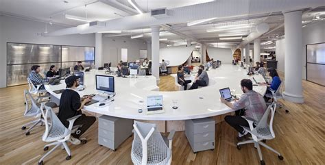 gorgeous office space this gorgeous office has an endless desk made by robots