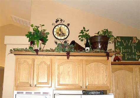 above kitchen cabinet decor ideas decorating above kitchen cabinets ideas afreakatheart