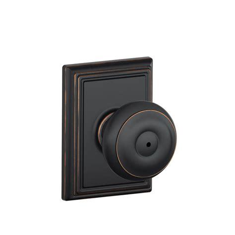 schlage locking interior bed bath knob georgian satin schlage georgian aged bronze bed and bath knob with