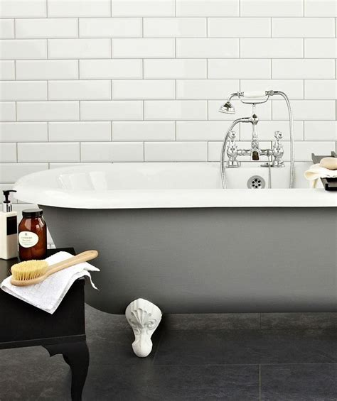 bathroom tiles topps tiles white bevelled metro tiles with pale grey grout