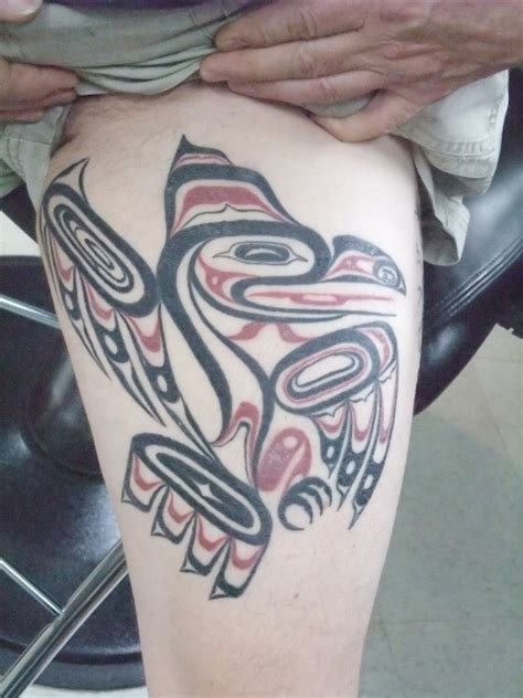 tribal tattoos vancouver tattooer bob moreau with a photo