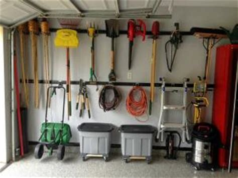Hang Lawn Mower In Garage by Garage Organization Ideas Lovetoknow