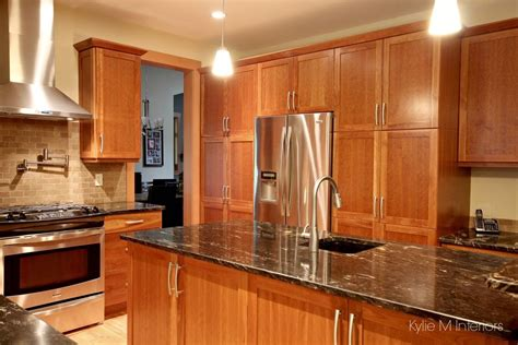 cherry cabinets with granite cherry cabinets in kitchen island pantry wall