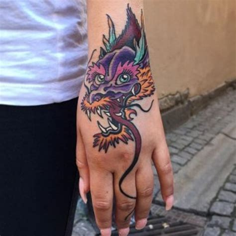 tattoo dragon on hand 18 amazing dragon wrist tattoos