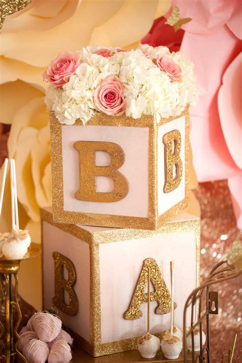 Pink And Gold Baby Shower Decor by Letter Blocks Topped With Florals From A Pink Gold