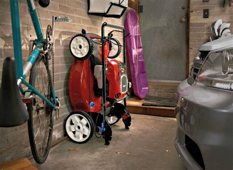 Garage Storage For Lawn Mower New Toro Mower Stands Up For Easy Storage Consumer Reports