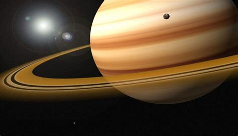saturn fact file nasa releases images of saturn s moon