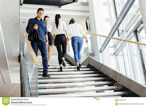 building a single stair walk up better cities towns group of businessman walking and taking stairs stock photo