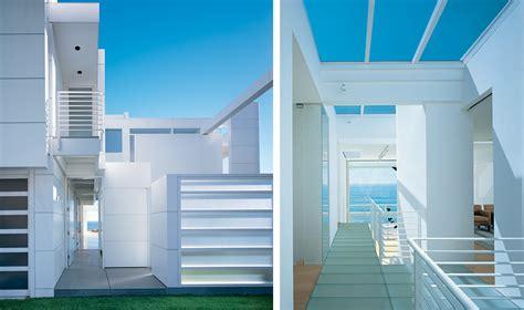 modern beach house  white exterior paint  richard
