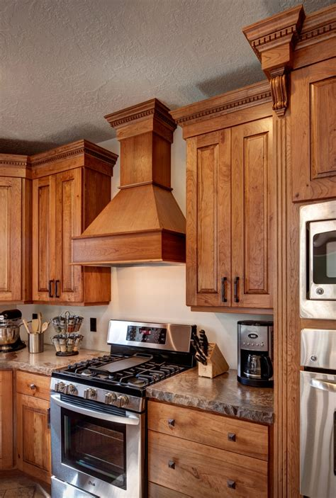 knotty hickory kitchen cabinets crown cabinets ridgeline xl knotty cherry ginger brown