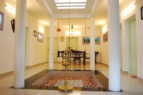 kerala home design with nadumuttam common area cum dining space picture of regal mansion