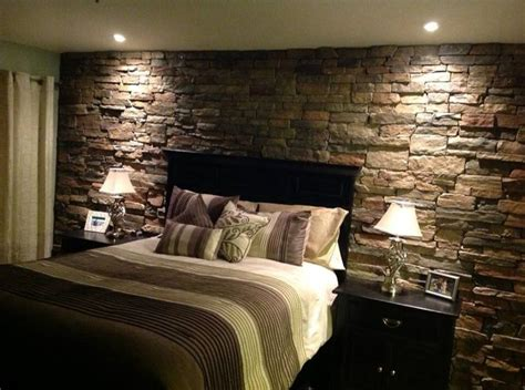 rock accent wall in the master bedroom home decor